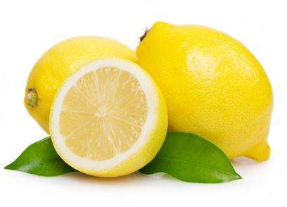 Fresh lemon with leaves
